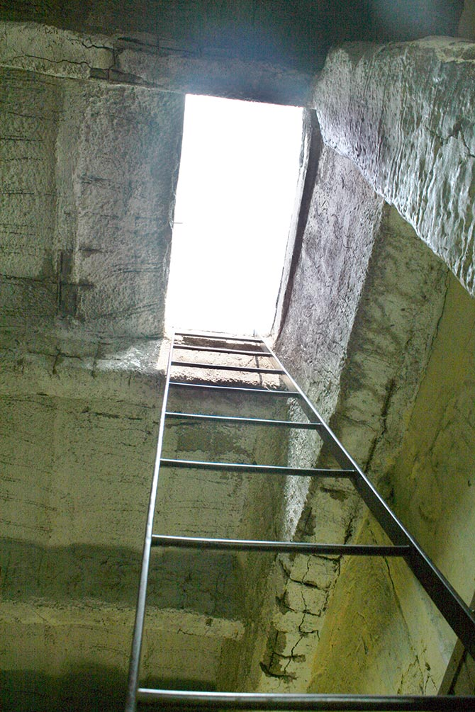 An iron staircase going to the roof
