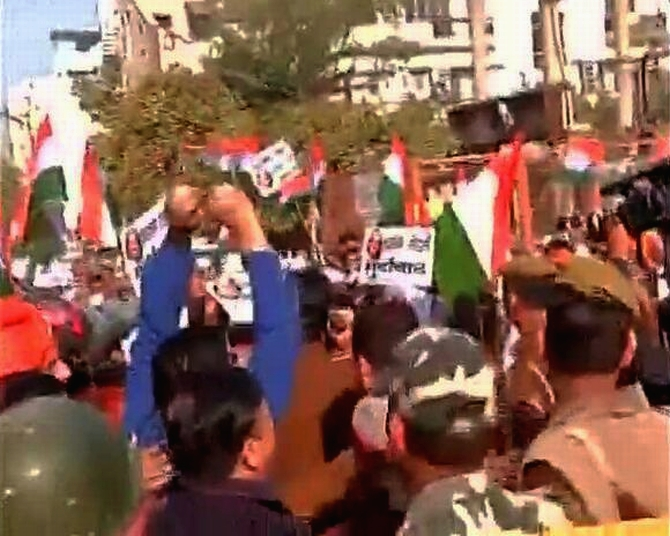 AAP supporters shout slogans in Kailash Colony