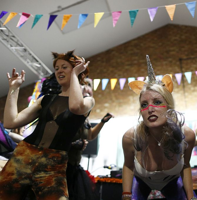 Revellers dance at Morning Glory, in a venue in Hackney, London. Morning Glory is a nightclub which operates once a month from 6:30 to 10:30 am, at which revellers drink fruit smoothies, coffee and dance to high energy music, sometimes in their sleepwear