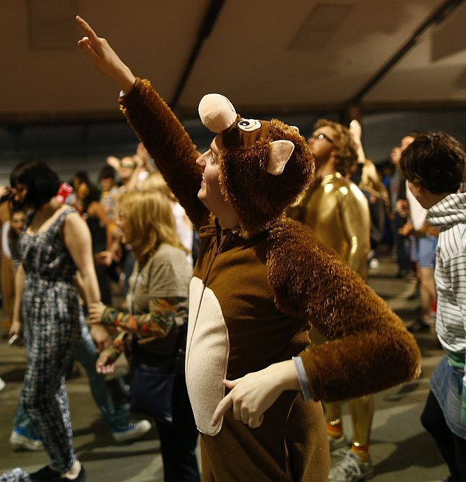 A reveller dances in his onesie at Morning Glory, in a venue in Hackney, London