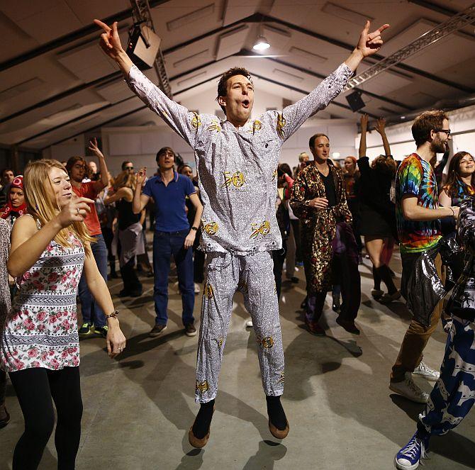 Revellers dance in their sleepwear at Morning Glory, in a venue in Hackney, London