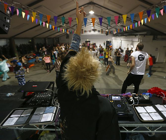 A DJ plays dance music to revellers at Morning Glory, in a venue in Hackney, London