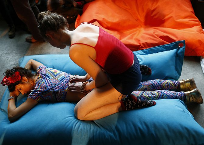 A reveller enjoys a massage at Morning Glory, in a venue in Hackney, London