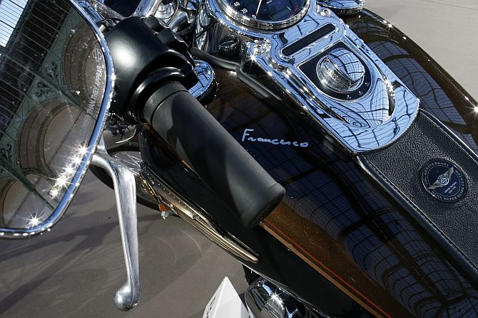 Pope Francis signature is seen on the tank of his 1,585 cc Harley Davidson Dyna Super Glide