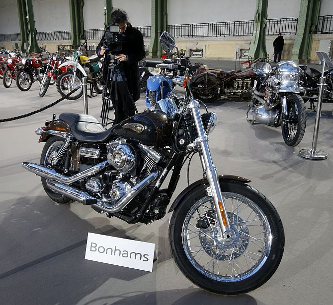 The 1,585 cc Harley Davidson Dyna Super Glide, donated to Pope Francis last year and signed by him on its tank, is displayed as part of Bonham's Les Grandes Marques du Monde vintage and classic cars sale at the Grand Palais in Paris
