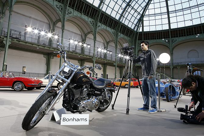 Cameramen shoot the 1,585 cc Harley Davidson Dyna Super Glide