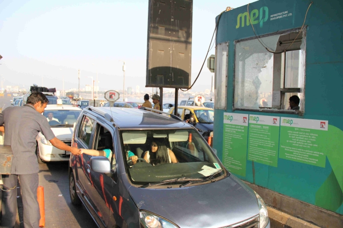 MNS workers vandalised the toll plaza on the Bandra Worli Sea Link