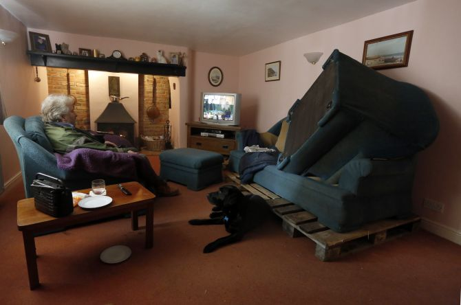 PHOTOS: Hundreds of homes inundated as UK floods spread