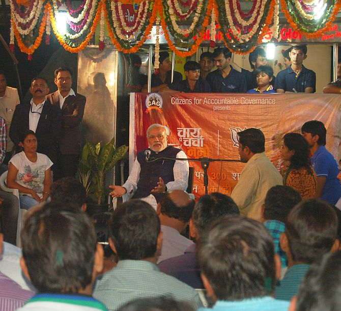 Narendra Modi interacts with people as he launched his 'Chai Pe Charcha' campaign on Wednesday.