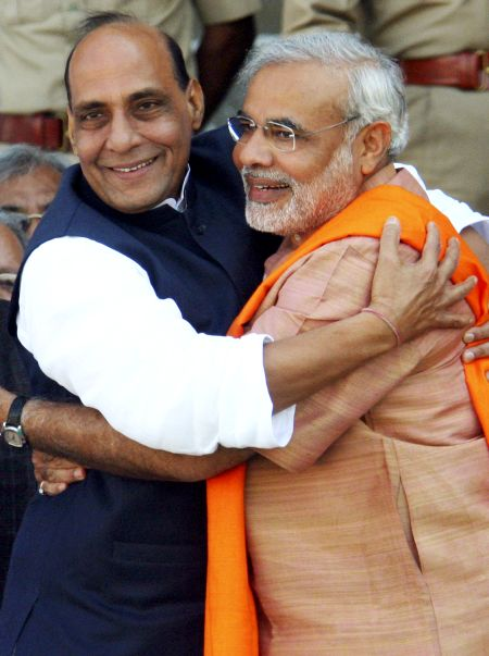 BJP's PM candidate Narendra Modi and BJP president Rajnath Singh. The survey has predicted that the party alone would secure 202 seats