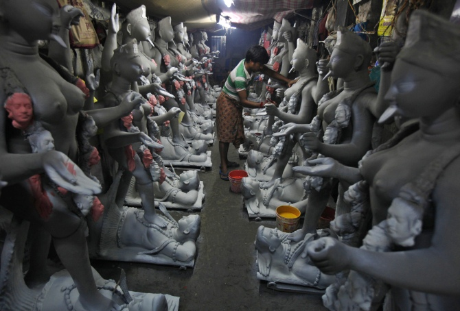 An artist paints an idol of Kali at a workshop in Kolkata.