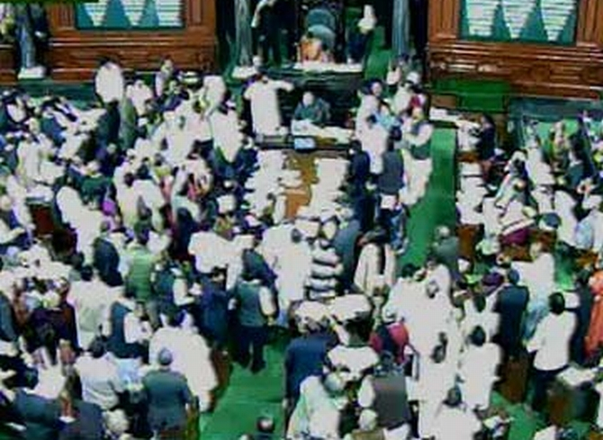 The ruckus in Lok Sabha over the Telangana Bill