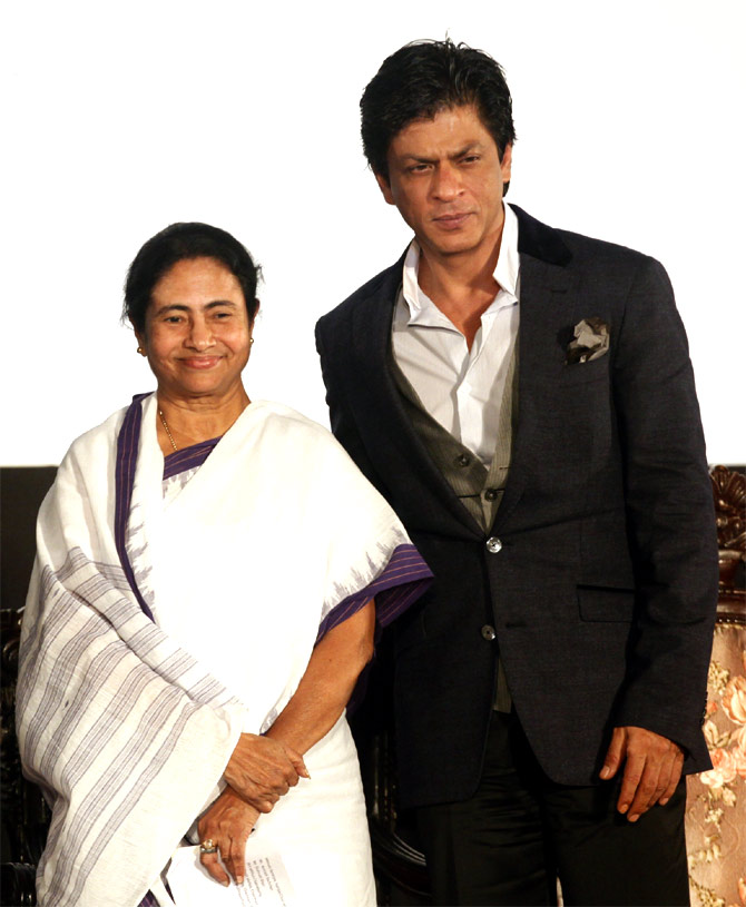 West Bengal Chief Minister Mamata Banerjee with actor Shah Rukh Khan at an event