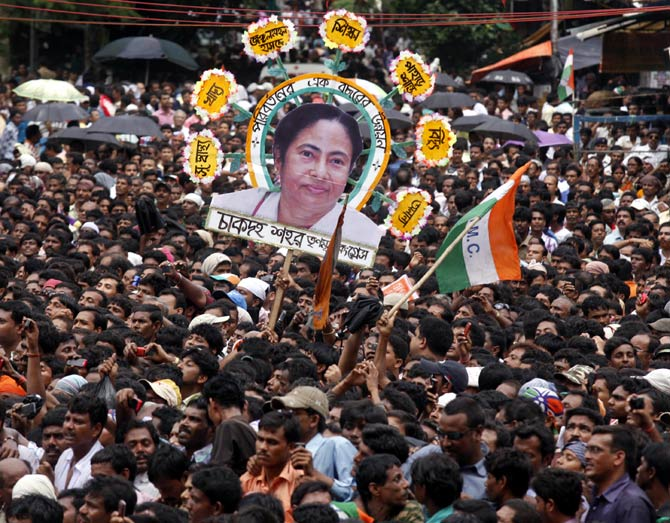 Supporters hold a cut-out of Bengal CM Mamata Banerjee