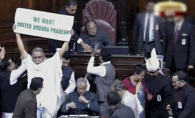 Telangana Bill moved in Rajya Sabha amid unprecedented chaos