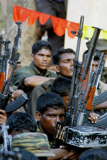 Tamil rebels keep watch during funeral procession of a slain commander at a Tamil rebel-controlled area in Batticaloa, eastern Sri Lanka in this photograph taken on May 24, 2006.