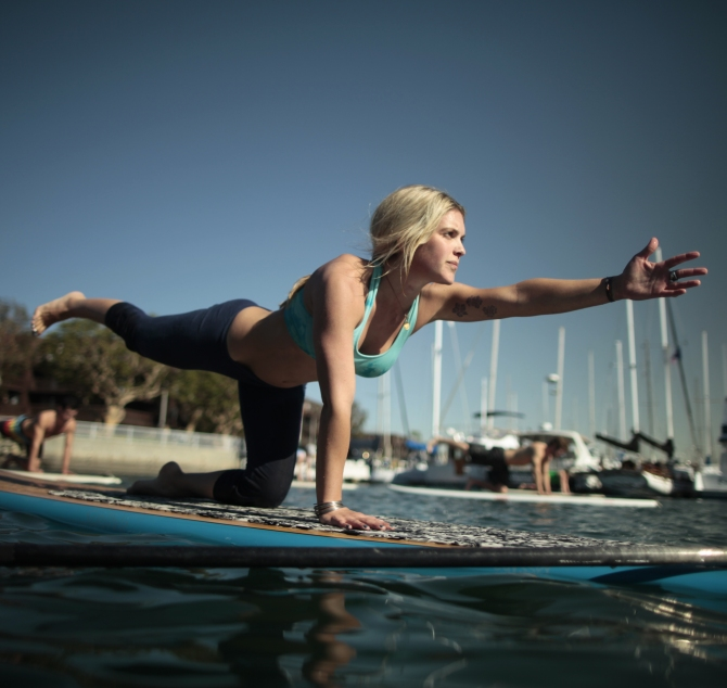 A Yoga instructor demonstrates a pose during her Yoga class