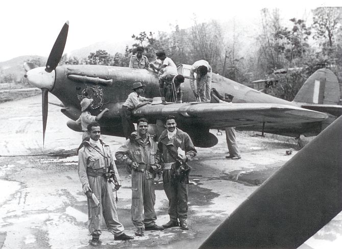 Flight Commander Squadron Leader Rajaram with pilots, technicians and a Hurricane during the Burma campaign in World War II