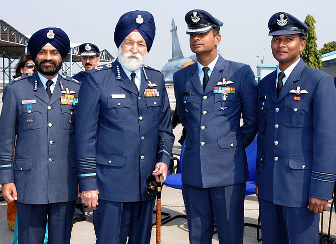 The legendary Marshal of the Air Force Arjan Singh, second from left, with Air Marshal Daljit Singh, left, and Wing Commander Pannu and Squadron Leader Kareem (right) at the Tigers's den at the Air Force Station in Gwalior.