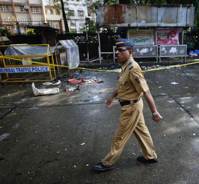A policeman walks past the site of an explosion at Dadar in Mumbai