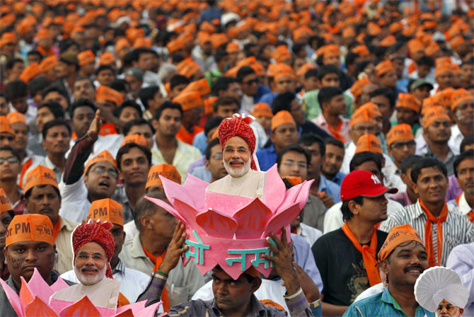 Narendra Modi supporters during a rally in Ahmedabad. Photograph: Amit Dave/Reuters