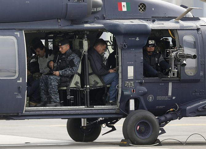 Joaquin Shorty Guzman is seen sitting inside a Mexican federal police helicopter at the Navy's airstrip in Mexico City
