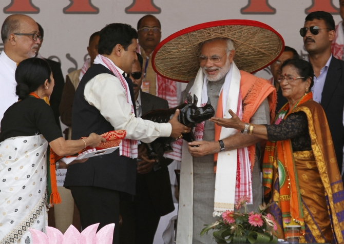 Modi is gifted a rhino at a rally in Guwahati