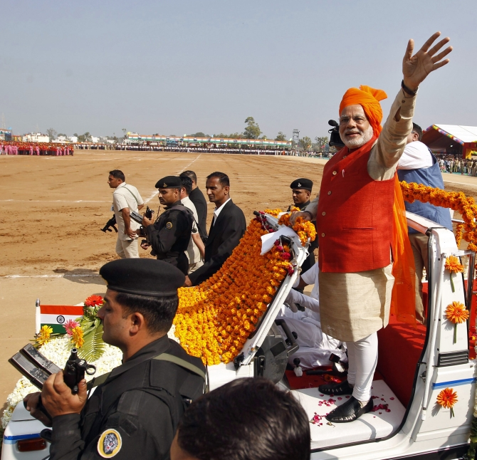 Narendra Modi waves to supporters in Gujarat.