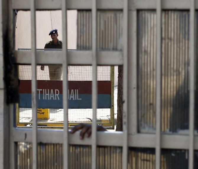 A police guard seen inside the Tihar Jail in New Delhi