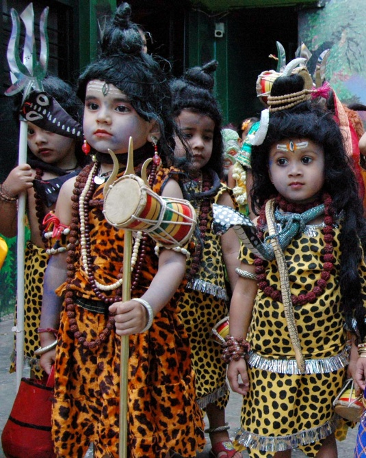 Children dressed as Lord Shiva take part in a religious procession on the eve of Mahashivaratri in Bhopal.