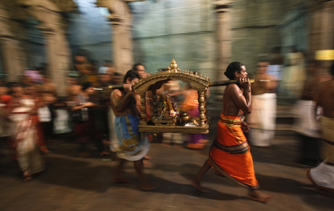 Priests carry a shrine of Lord Shiva to bless devotees as they pray during the annual Maha Shivaratri festival at Shivam Kovil in Colombo.