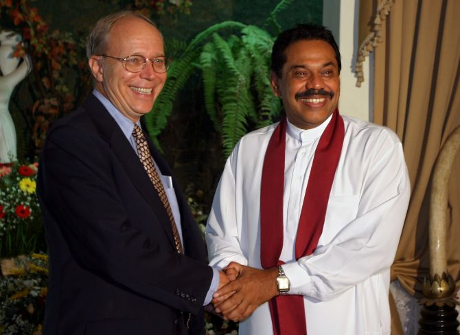 Then US ambassador Jeffrey Lunstead greets then Sri Lankan prime minister (now President) Mahinda Rajapakse in Colombo on April 8, 2004.