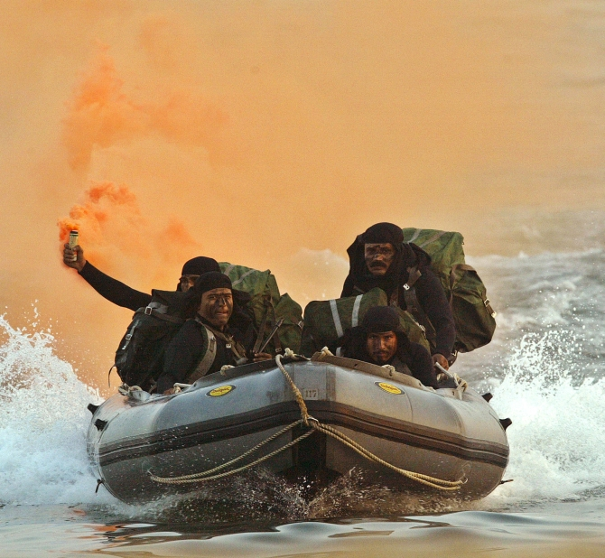 Marine commandoes of the Indian Navy show their skills in Visakhapatnam.