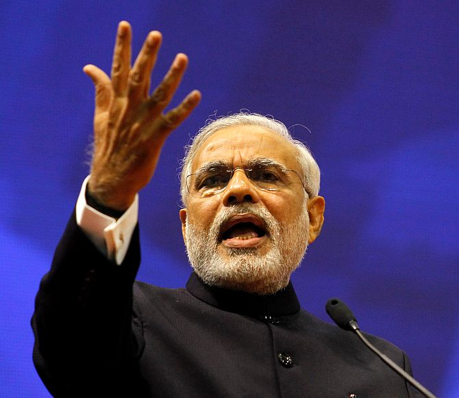 "Gujarat's chief minister Narendra Modi speaks during the ""Vibrant Gujarat Summit"" at Gandhinagar in Gujarat January 12"