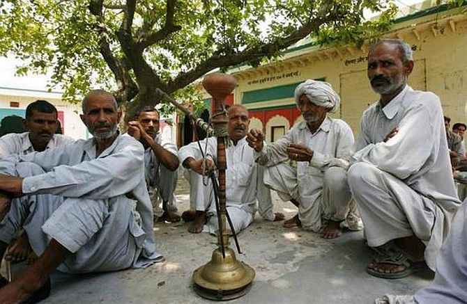 Villagers sit after attending a panchayat, or village council meeting, at Balla village in Haryana
