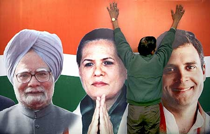 A poster of Prime Minister Manmohan Singh, Congress President Sonia Gandhi and party vice president Rahul Gandhi