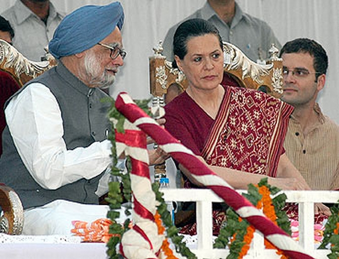 Prime Minister Manmohan Singh with Congress President Sonia Gandhi and party vice president Rahul Gandhi