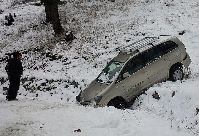 A vehicle slips off the road post snowfall in Srinagar