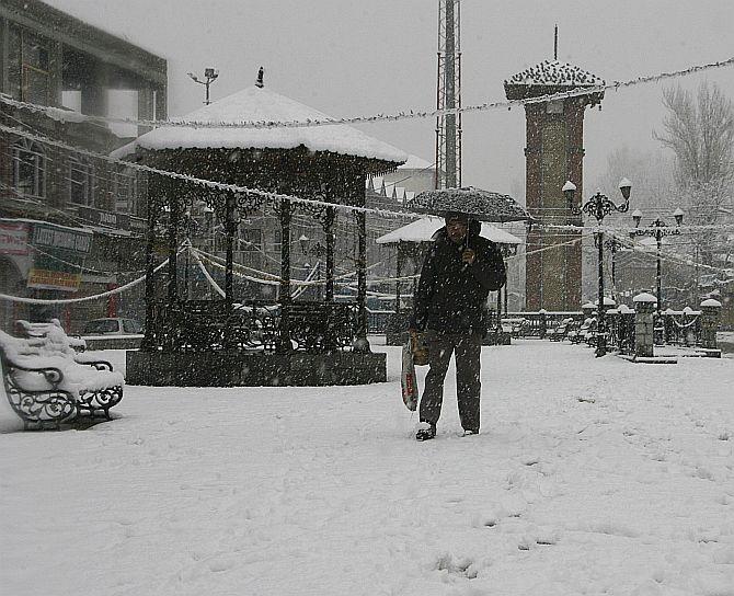 A Kashmiri braves the snowfall in Srinagar