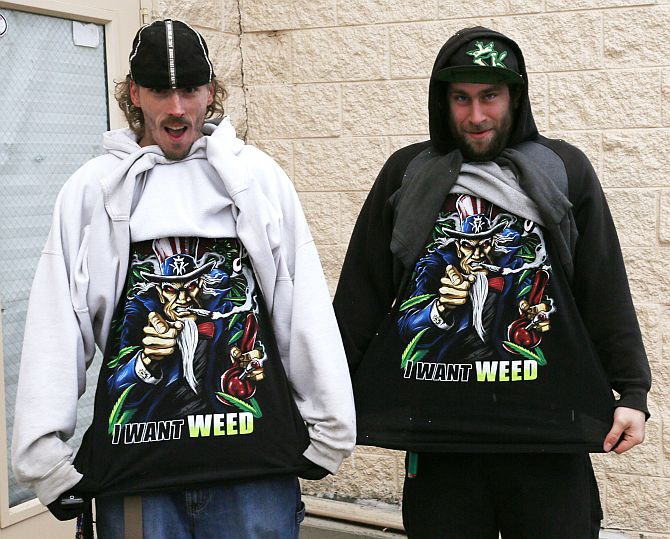 Mark Gordon (left) and Ryan Perry display their I Want Weed t-shirts as they wait in line to be among the first to legally buy recreational marijuana at the Botana Care store in Northglenn, Colorado