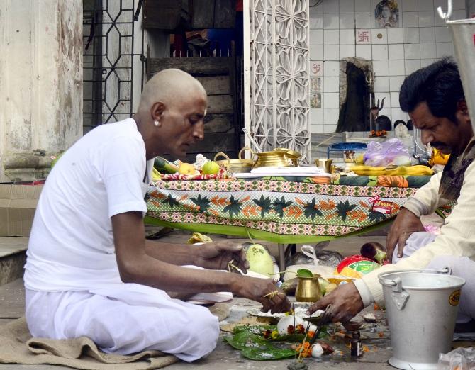 Jha performs rituals for his daughter at Nimtala in Kolkata
