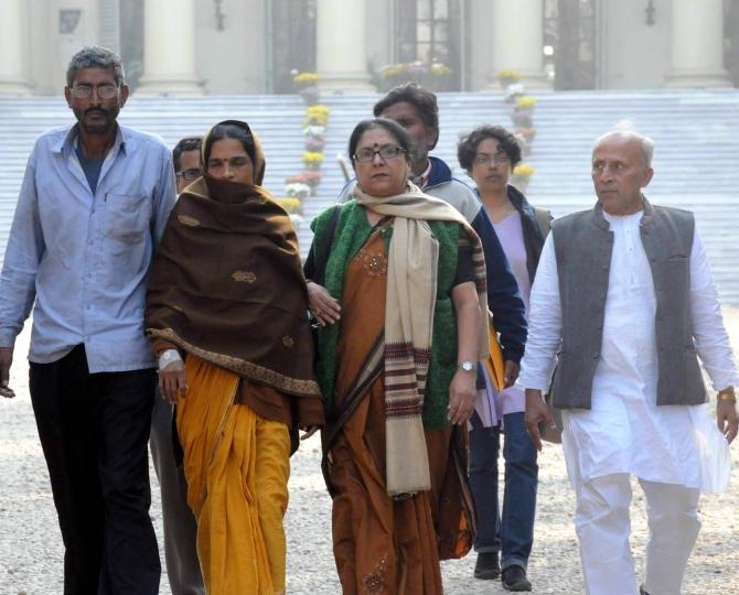 Ramshankar Jha and Anita Jha, parents of the victim, along with CITU leaders outside Raj Bhavan