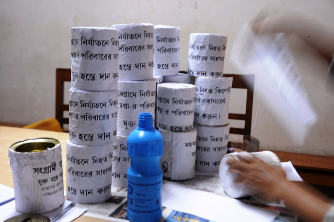 Donation boxes being prepared to collect funds for the family
