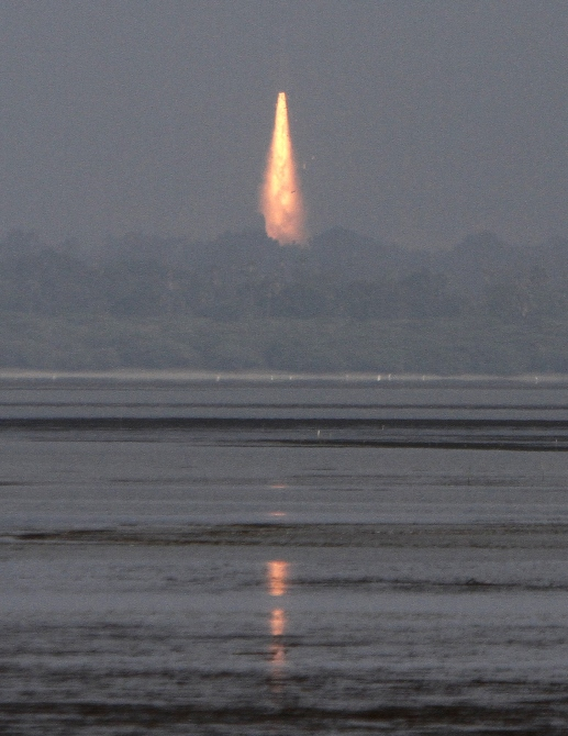A contrail is seen as India's Geosynchronous Satellite Launch Vehicle blasts off carrying a 1,980 kg GSAT-14 communication satellite from the Satish Dhawan space centre at