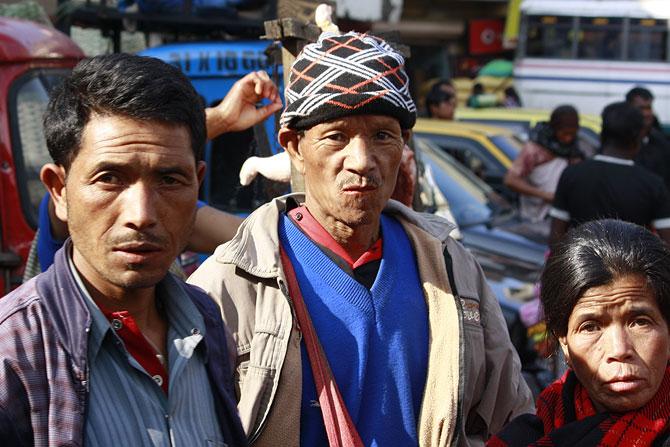 Locals waiting to cross the road at Shillong's Bara Bazar.