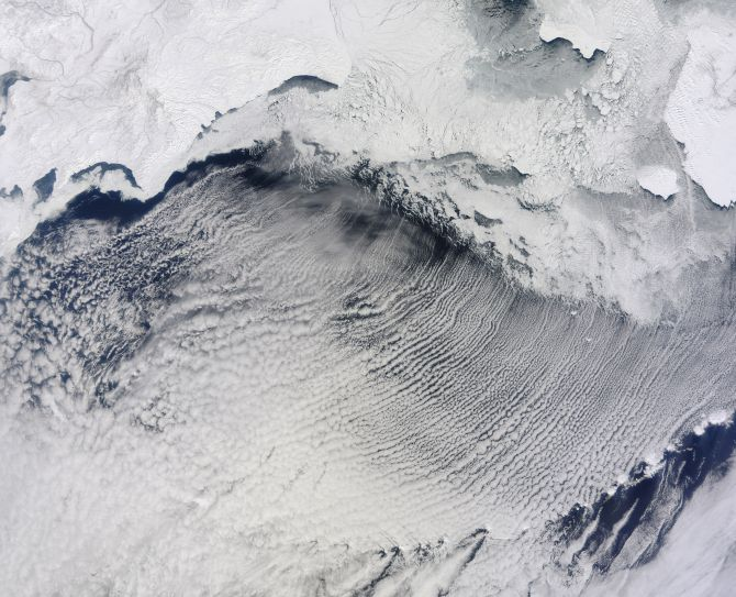 Clouds stretch in parallel rows for hundreds of kilometers over the Bering Sea in this NASA handout photo