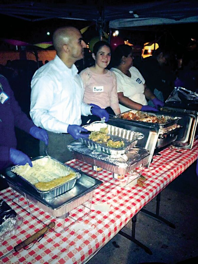 Neel Kashkari, left, volunteers at a soup kitch