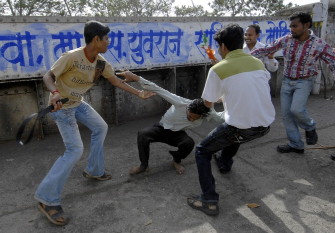 MNS party workers attack a man while targeting people leaving a Samajwadi Party rally in Mumbai in this photograph taken on February 3, 2008.