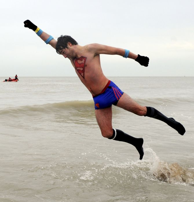 ODD WORLD: Superman takes first bath of 2014 in the North Sea