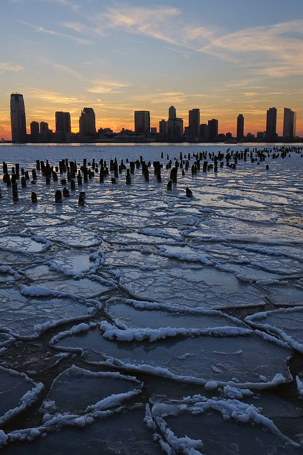 Ice floes fill the Hudson River as the New Jersey waterfront is seen during sunset on January 9, 2014 in New York City